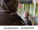 tourist looking traveling guide ...   Shutterstock . vector #763303999