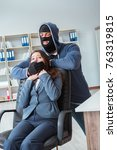 Small photo of Criminal taking businesswoman as hostage in office
