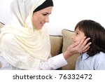 Muslim mother and son relaxing at the home - stock photo