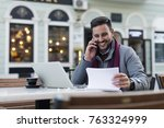 smiling young businessman... | Shutterstock . vector #763324999