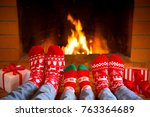 family in christmas socks near... | Shutterstock . vector #763364689