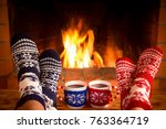 couple in christmas socks near... | Shutterstock . vector #763364719