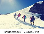 group of climbers reaches the... | Shutterstock . vector #763368445