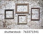 old photo frames on brick wall | Shutterstock . vector #763371541