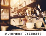 white cup standing beneath a... | Shutterstock . vector #763386559