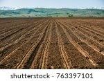 arable land in the highlands.... | Shutterstock . vector #763397101