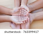 parent and children holding... | Shutterstock . vector #763399417
