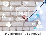 doctor pushing button faq... | Shutterstock . vector #763408924