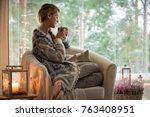 Young Beautiful Woman Sitting...