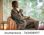 young beautiful woman sitting... | Shutterstock . vector #763408957