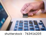 plugging sd card into laptop... | Shutterstock . vector #763416205