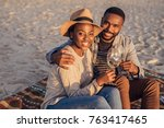 smiling young african couple... | Shutterstock . vector #763417465