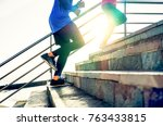 couple running on stairs at... | Shutterstock . vector #763433815