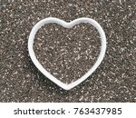 heart shaped bowl of chia seeds ... | Shutterstock . vector #763437985
