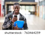 male college student reading... | Shutterstock . vector #763464259