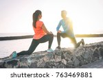 young health couple stretching... | Shutterstock . vector #763469881