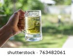 hand holding a mug of beer...   Shutterstock . vector #763482061