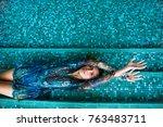 sensual woman in dress lying... | Shutterstock . vector #763483711