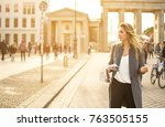 young woman with a city map... | Shutterstock . vector #763505155
