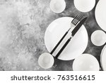 clean white tableware on a gray ... | Shutterstock . vector #763516615