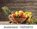 bowl with delicious ripe fruits ... | Shutterstock . vector #763518721