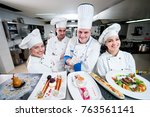 kitchen chef with young... | Shutterstock . vector #763561141