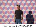 young hipster man in cap...   Shutterstock . vector #763561555