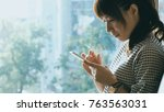 woman use of mobile phone | Shutterstock . vector #763563031