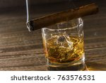 whiskey and cigar   Shutterstock . vector #763576531