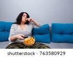 couch potato overweight woman... | Shutterstock . vector #763580929