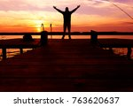 silhouette of man standing on a ... | Shutterstock . vector #763620637