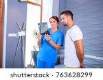 a dentist explaining the... | Shutterstock . vector #763628299