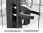 the door handle on the door ... | Shutterstock . vector #763650565