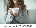 Woman In A Sweater Drinking Tea