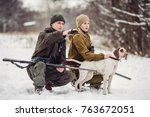 two hunters with rifles in a... | Shutterstock . vector #763672051