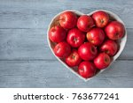 red apples in a heart shaped... | Shutterstock . vector #763677241