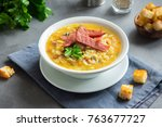 split pea soup with smoked ham... | Shutterstock . vector #763677727