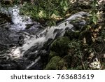 Small photo of Small waterfall near swan pond in Manlius New York