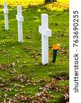 Three White Crosses On Green...
