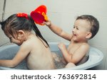 brother and sister swimming in... | Shutterstock . vector #763692814