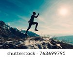 man poses and jumps at snowy... | Shutterstock . vector #763699795