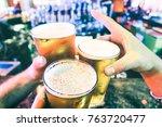 friend hands toasting beer...   Shutterstock . vector #763720477