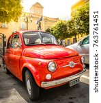 vintage red fiat 500 car parked ...