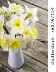 daffodils on weathered table | Shutterstock . vector #763767154