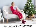 young woman is sitting on a... | Shutterstock . vector #763775749