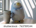Penguin Toy With Cup Sitting By ...
