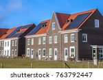 modern row houses with solar... | Shutterstock . vector #763792447