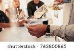 close up of male hands serving... | Shutterstock . vector #763800865