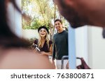 smiling young couple at... | Shutterstock . vector #763800871