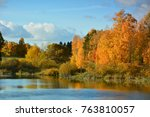 autumn landscape with lake | Shutterstock . vector #763810057
